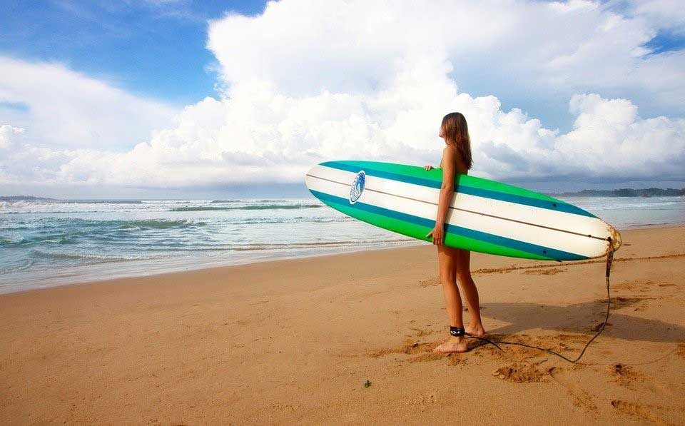 Female with long surfboard