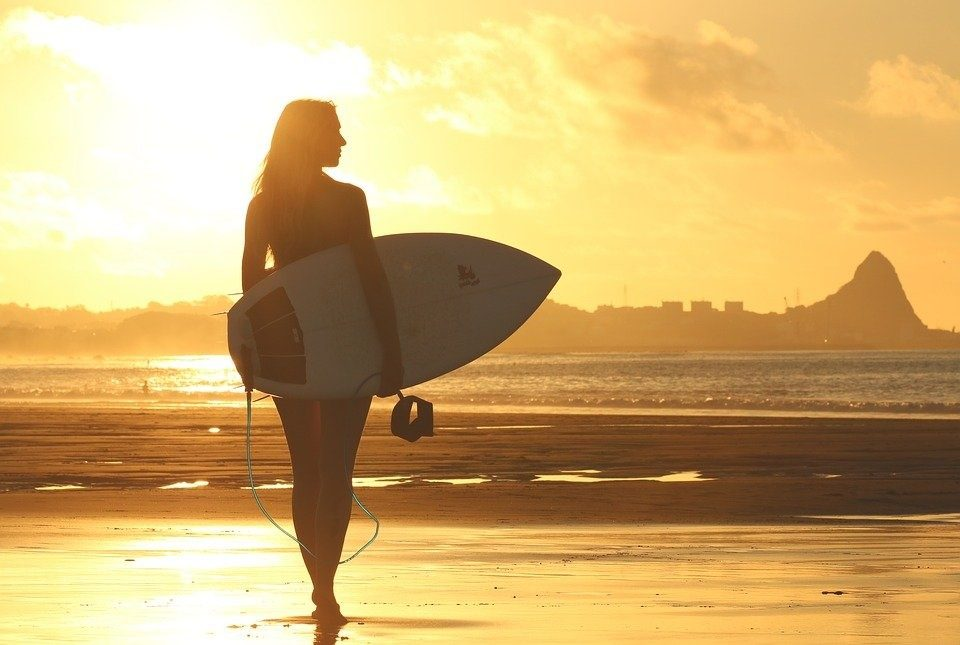 Female surfer with board
