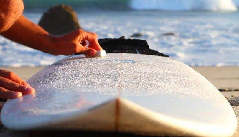 Surfboard waxing close view